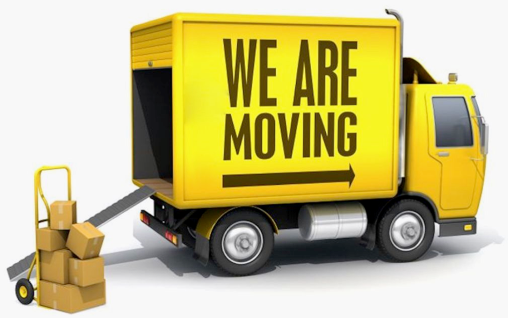 Moving Truck with message saying we are moving and moving boxes